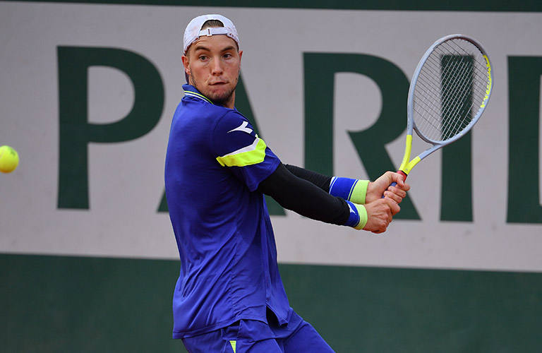 J.L.Struff hitting a backhand at Rolland Garros