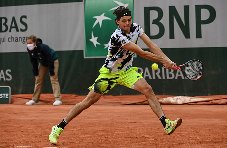 Talyor Fritz hitting a bakchand at French Open