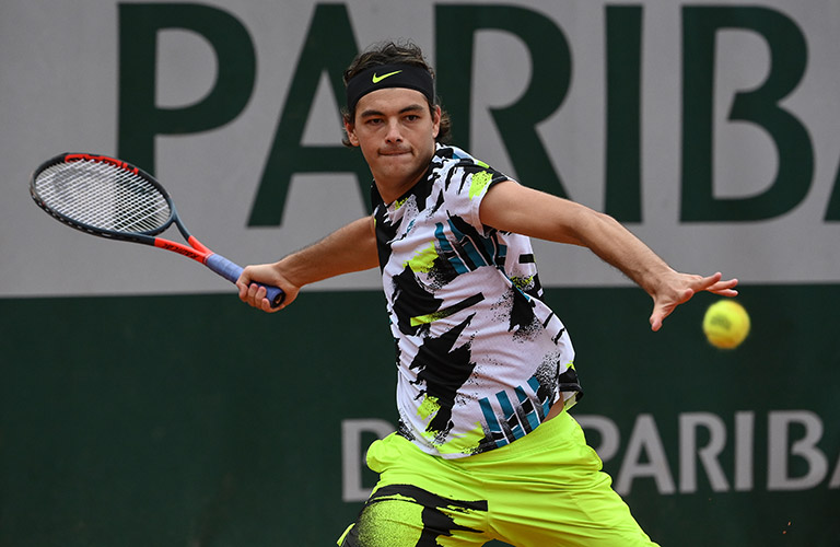 Talyor Fritz hitting a forehand at French Open