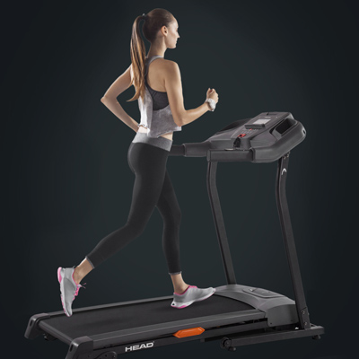 Woman on a HEAD fitnes treadmill