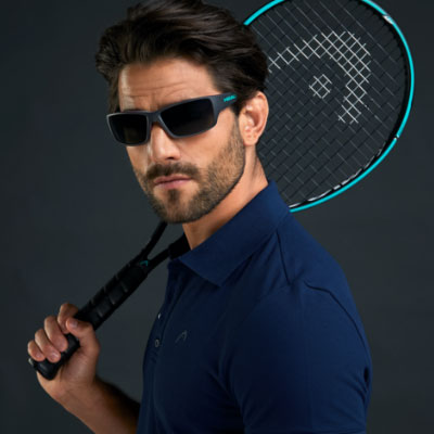 A tennis player wears HEAD sunglasses.